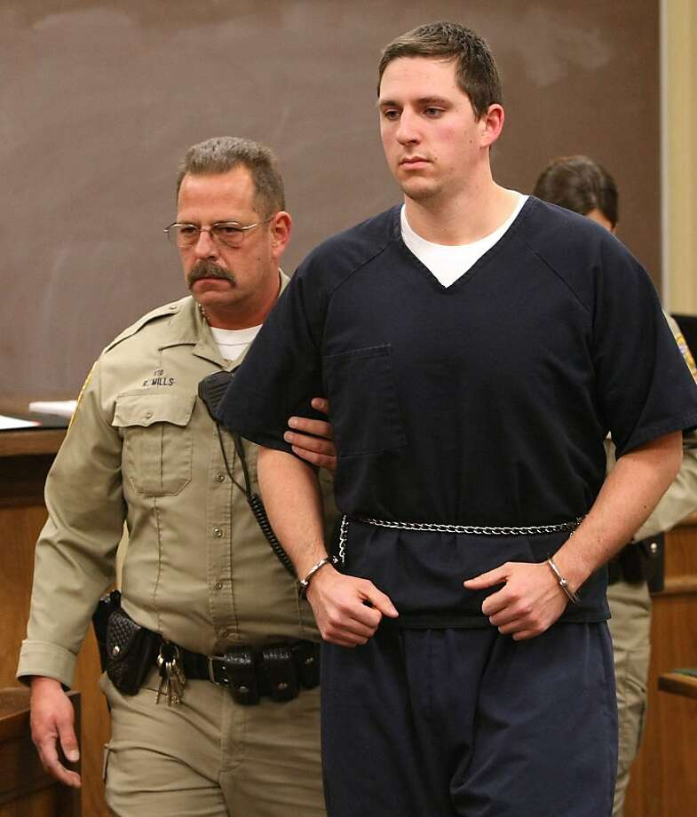FILE - This Jan 14, 2009 file photo shows Johannes Mehserle, right, in the East Fork Justice Court in Minden, Nev. A jury reached a verdict Thursday, July 8, 2010, in  Mehserle's trial, a former San Francisco Bay area transit officer accused of murderingan unarmed black man on an Oakland train platform. The eight woman, four-man panel is scheduled to read the verdict at 4 p.m. PDT. Photo: Cathleen Allison, AP