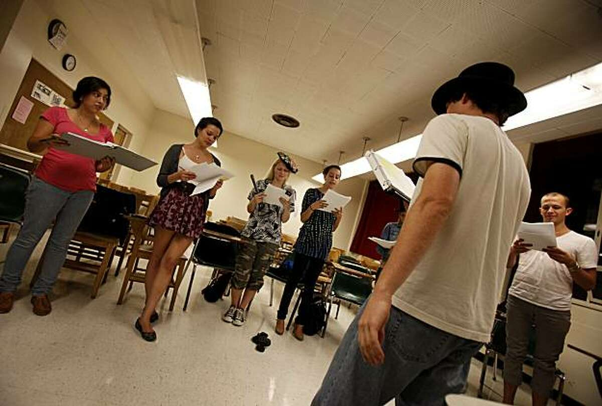 Ben Calabrese (right) narrates part of the play while other students sing background Wednesday September 29, 2010. Joel Schechter, the theatre arts professor at San Francisco State University, believes that federal stimulus funds should be used to start a Works Progress Administration-type program to support the arts during the current recession.