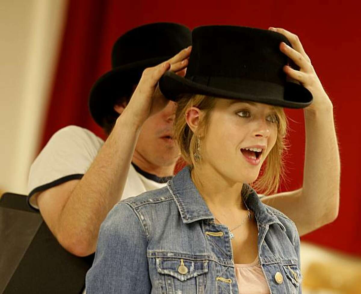 Jocelyn McMahon gets presented with a top hat after she begins to understand the stock market during a WPA style play rehearsal Wednesday September 29, 2010. Joel Schechter, the theatre arts professor at San Francisco State University, believes that federal stimulus funds should be used to start a Works Progress Administration-type program to support the arts during the current recession.