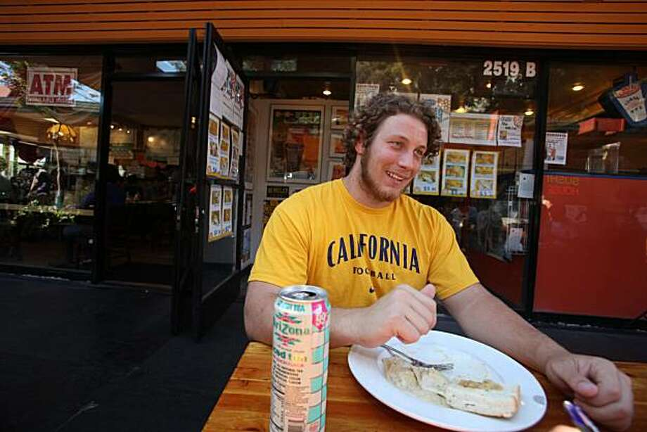 Cal Bears Football player, Richard Fisher,  who stands 6'-5' and weighs 280 pounds, chows down on a plate of vegetarian ravioli in Berkeley at Gypsy's Trattoria Italiana on Monday, September 27, 2010.  Kat Wade / Special to the Chronicle Photo: Kat Wade, Special To The Chronicle