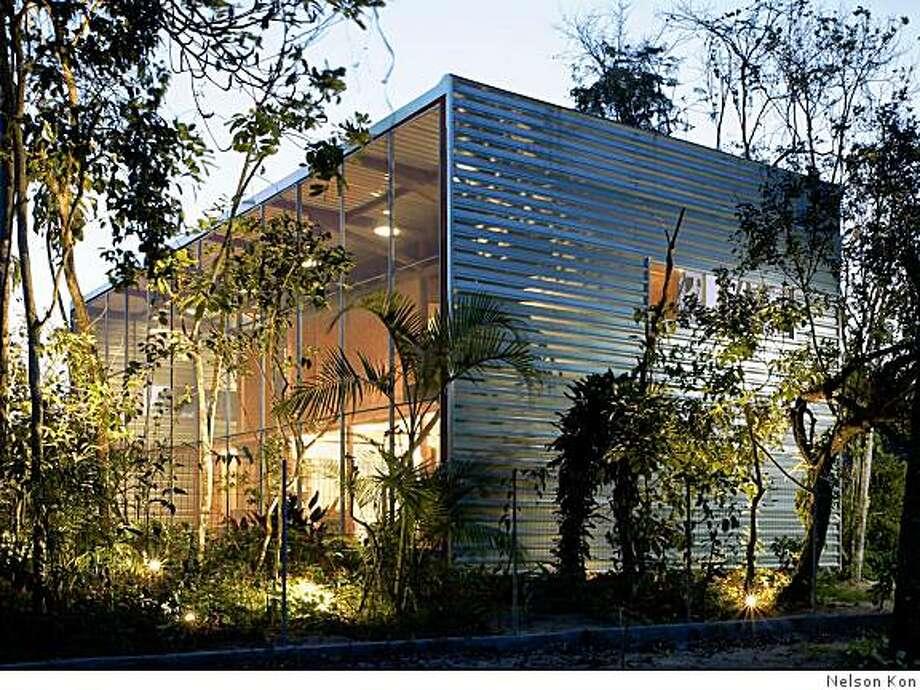 Andrade-Morettin: Residencia RR vacation home; utilize sustainable pre-fabrication principles; http://www.madarchitect.org/futuristic/prefab-residencia-rr-in-sao-paulo-brazil/ (Itamambuca, Brazil) Patrick Hendry Photo: Nelson Kon