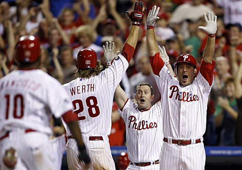 From right, Philadelphia Phillies' Greg Dobbs, Brian Schneider, Jayson Werth and Ben Francisco celebrate after a walk-off two-run RBI double by Carlos Ruiz in the ninth inning of a baseball game against the Los Angeles Dodgers, Thursday, Aug. 12, 2010, inPhiladelphia. Philadelphia won 10-9. Photo: Matt Slocum, AP