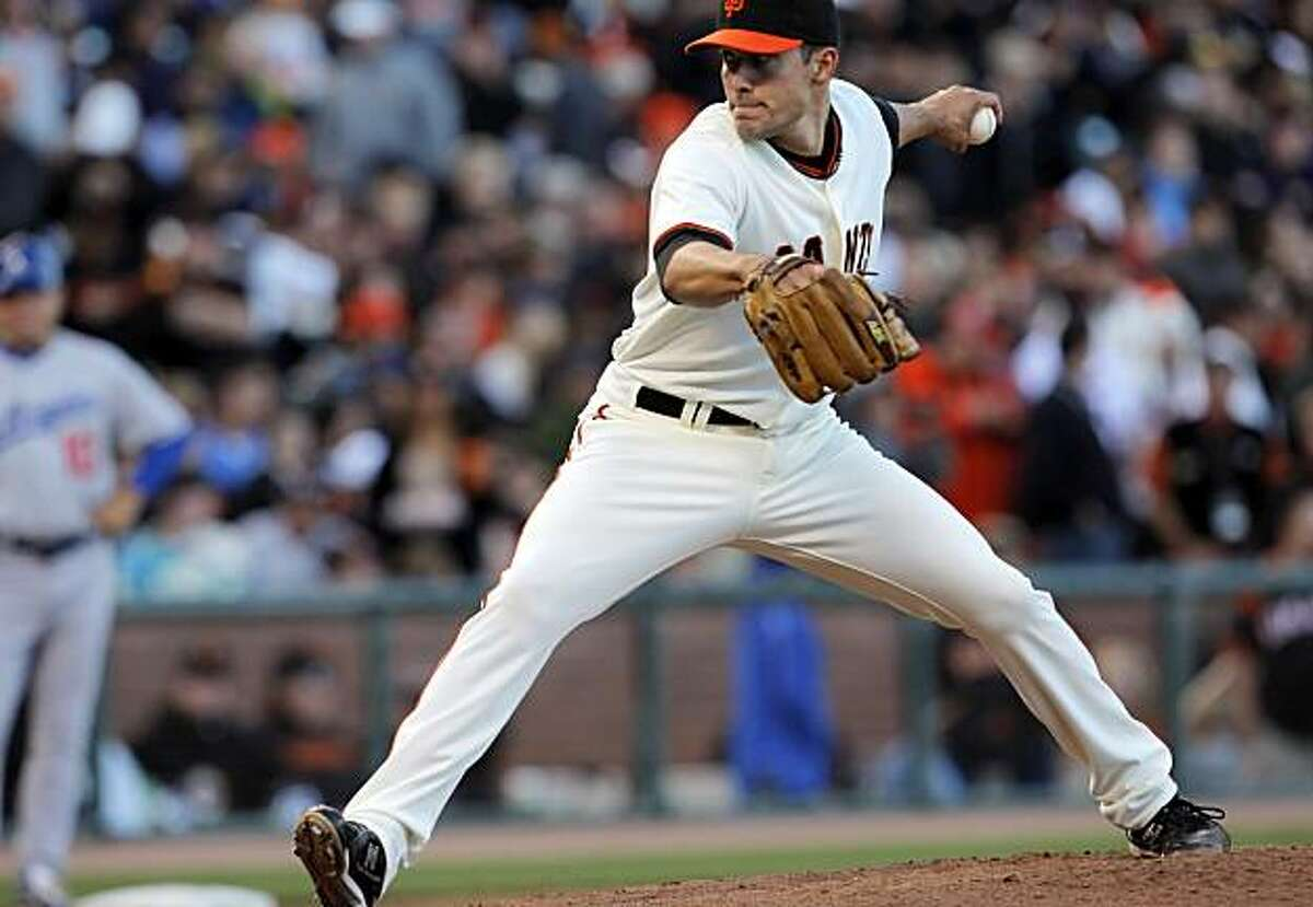 The Giants' new left-handed relief pitcher, Javier Lopez, pitches in the eighth inning against the Dodgers at AT&T Park on Sunday.
