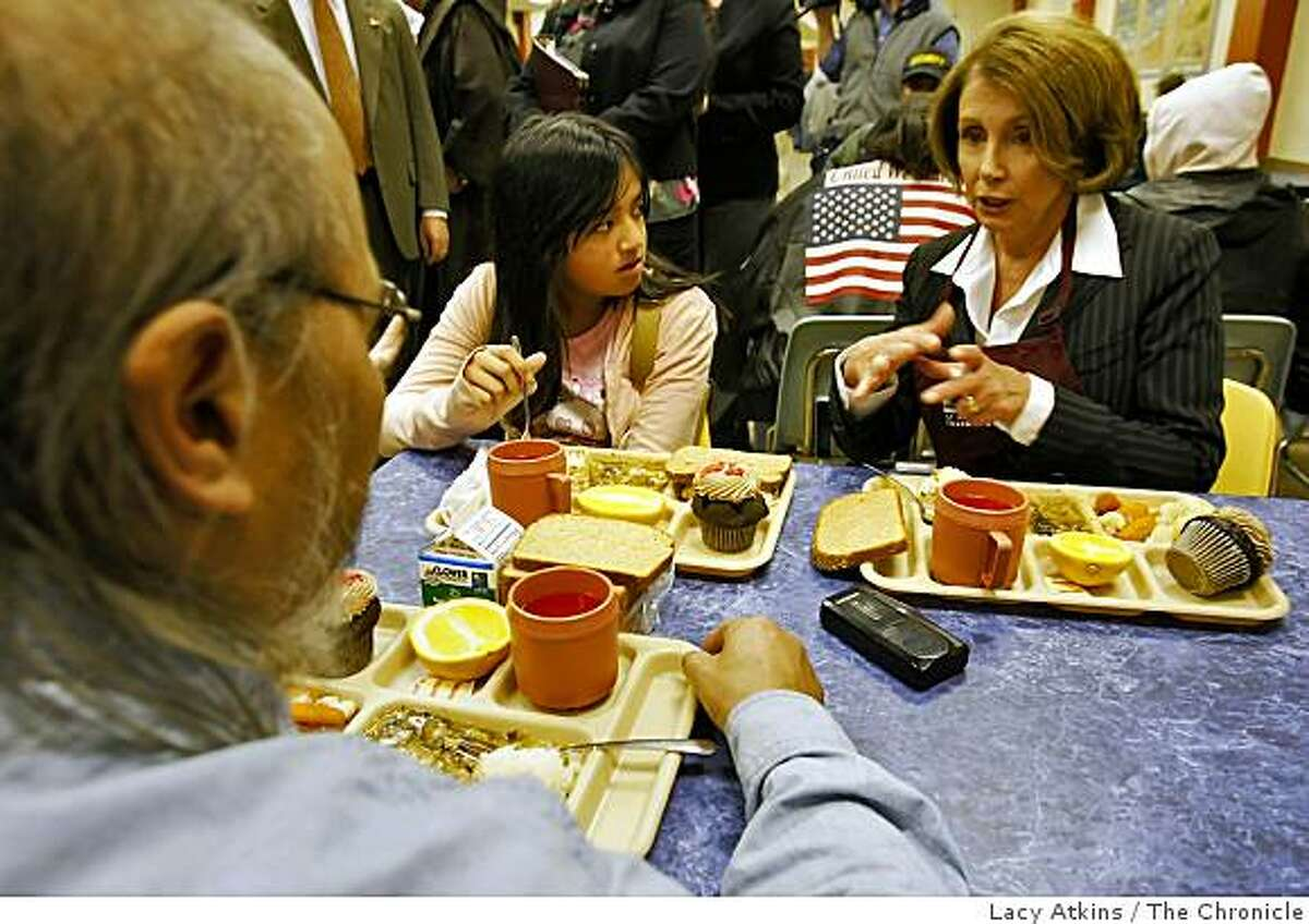 Speaker of the House Nancy Pelosi (right) talks with Gigi Serafino ( left) who was serviced the 35 million meal and her grandfather Winston Lee at the San Francisco community at the St. Anthony Foundation dining room, Sunday Feb. 8, 2009, in San Francisco, Calif.