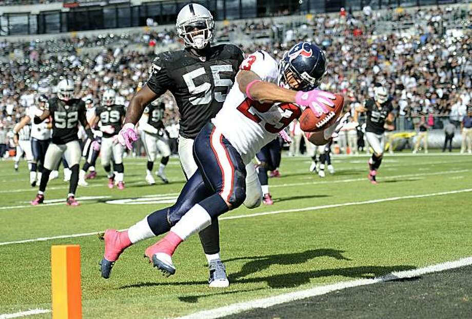 OAKLAND, CA - OCTOBER 3:  Running back Arian Foster #23 of the Houston Texans scores a touchdown in front of linebacker Rolando McClain #55 of the Oakland Raiders  during an NFL football game October 3, 2010 at The Oakland-Alameda County Coliseum in Oakland, California. The Texans won the game 31-24. Photo: Thearon W. Henderson, Getty Images