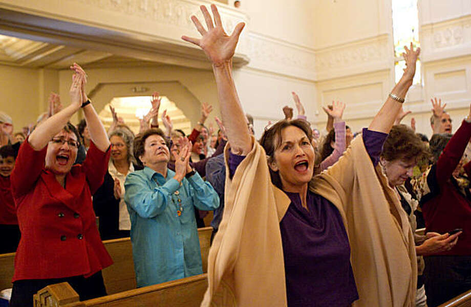 Robin Reiner, Sandy Goldberg, Judy Rosloff (left to right) and other members of the Temple Sinai congregation sing along to a concert by Rick Recht during dedication ceremonies for their new building at the temple in Oakland, Calif., on Sunday, October 3, 2010. Photo: Laura Morton, Special To The Chronicle