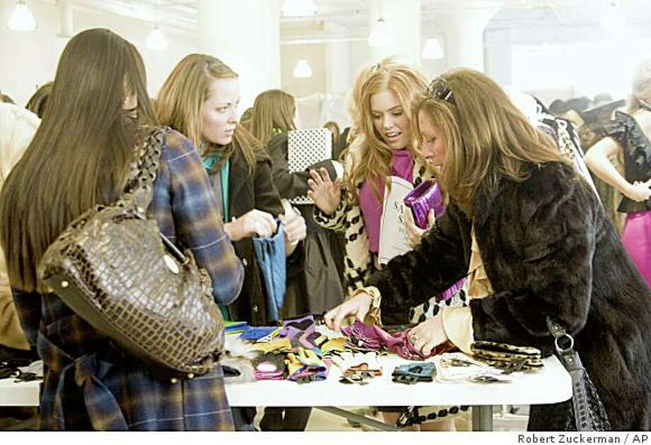 """In this image released by Disney, Isla Fisher, second right, is shown in a scene from, Touchstone Pictures' """"Confessions of a Shopaholic."""" Photo: Robert Zuckerman, AP"""