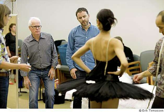Designer Jonathan Fensom (center) and Choreographer Helgi Tomasson oversee costume fitting for Yuan Yuan Tan. Photo: Erik Tomasson Erik Tomasson, � Erik Tomasson