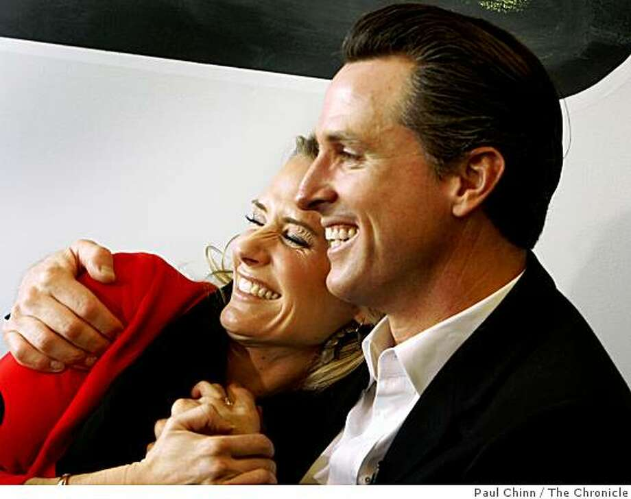 Mayor Gavin Newsom and his wife Jennifer Siebel Newsom smile after launching the city's Train for Charity event at Crunch Fitness on Union Street in San Francisco, Calif., on Tuesday, Feb. 10, 2009. Photo: Paul Chinn, The Chronicle