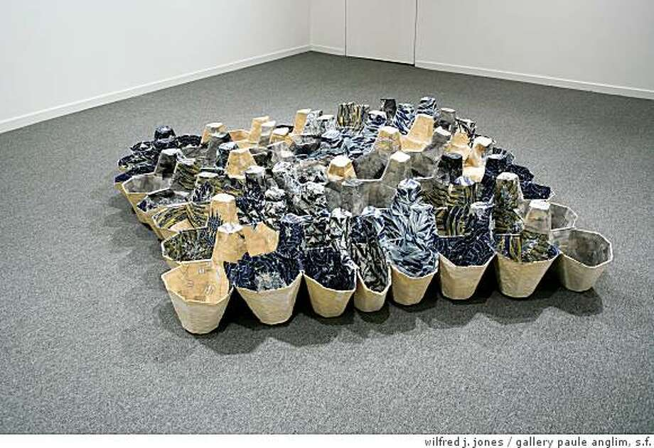 """""""Crate Wave"""" (2009) cast paper, inkprint print on rice paper & glue by Gay Outlaw, 15"""" x 6' x7' Photo: Wilfred J. Jones, Gallery Paule Anglim, S.f."""