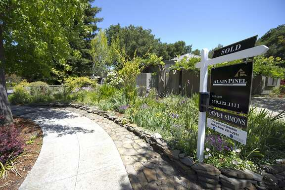 A sold sticker is displayed on a for sale sign outside of a home in Palo Alto, California, U.S., on Wednesday, June 8, 2011. Silicon Valley property booms start in Palo Alto, which is adjacent to the Stanford University campus, and Cupertino, home of Apple Corp., because of those institutional links and the areas' coveted public schools, said economist Stephen Levy. Photographer: David Paul Morris/Bloomberg