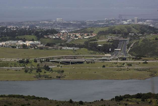 Crystal Springs Resevoir is seen in the foreground while homes and other structures are seen west of Hwy 280 in San Mateo County, Calif. on Tuesday March 30, 2010. According to a report much of the land preserved over the 50 years in Silicon Valley would have onlly been marginally used for housing. Photo: Lea Suzuki, The Chronicle