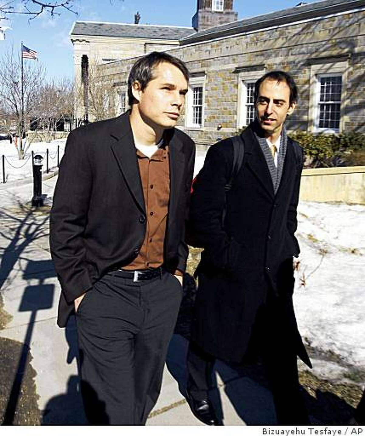 Shepard Fairey, left, and his attorney Jeffrey Wiesner, leave Brighton section of Boston District Court, Monday, Feb. 9, 2009. Fairey , 38, the controversial street artist who gained fame with his red, white and blue posters of President Barack Obama was arrested and charged in Boston with damage to property for having painted two Boston area locations with graffiti. (AP Photo/Bizuayehu Tesfaye)