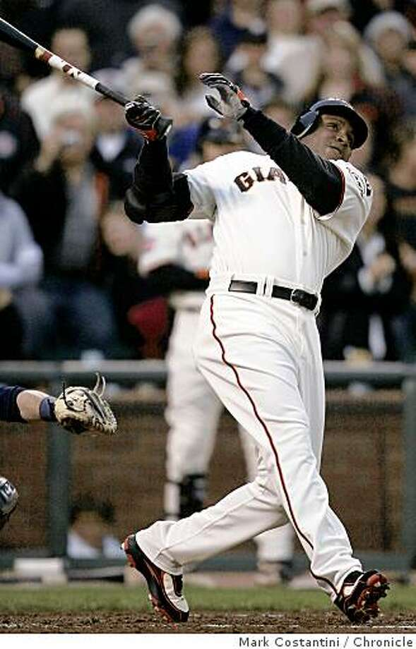 Ran on: 08-09-2007 Barry Bonds watches home run No. 757 leave the park and the national media was nowhere around to see it. Ran on: 08-09-2007 Photo: Mark Costantini, Chronicle