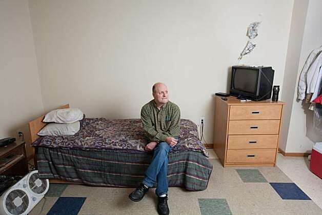 Kelly Lauderdale sits on his bed in the residential facility he has lived at for approximately four years at 1811 Eastlake in Seattle, Wash. on Friday, October 1, 2010. 1811 Eastlake is a government-subsidized Seattle apartment complex built for hard-core street drunks who can keep drinking and still keep a roof over their heads. Photo: Meryl Schenker, Special To The Chronicle