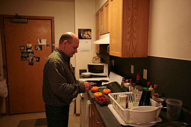 Kelly Lauderdale enjoys cooking in the residential facility he has lived at for approximately four years at 1811 Easlake in Seattle, Wash. on Friday, October 1, 2010. 1811 Eastlake is a government-subsidized Seattle apartment complex built for hard-core street drunks who can keep drinking and still keep a roof over their heads. Photo: Meryl Schenker, Special To The Chronicle