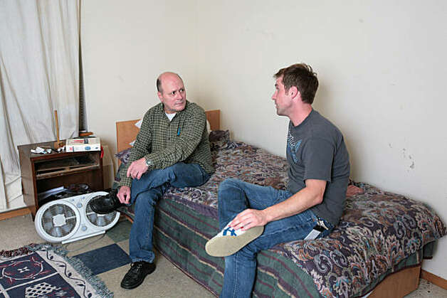 Kelly Lauderdale, left, talks to David Anderson, a residential counselor, at 1811 Eastlake in Seattle, Wash. on Friday, October 1, 2010. 1811 Eastlake is a government-subsidized Seattle apartment complex built for hard-core street drunks who can keep drinking and still keep a roof over their heads. Photo: Meryl Schenker, Special To The Chronicle