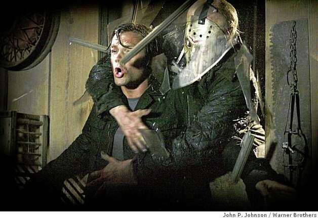 Jason (DEREK MEARS, right) crashes through a window and grabs Clay (JARED PADALECKI, left) in New Line Cinema's and Paramount Pictures' horror film 'Friday the 13th,' a Warner Bros. Pictures release. Photo: John P. Johnson, Warner Brothers