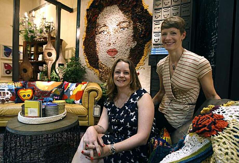 Senior visual manager Amber van Weerden (left), and Rachel Robertson, senior display coordinator, are seen in front of a large portrait, created with knotted cloth, at the Anthropologie store on Market Street in San Francisco, Calif., on Friday, July  30, 2010. Photo: Paul Chinn, The Chronicle