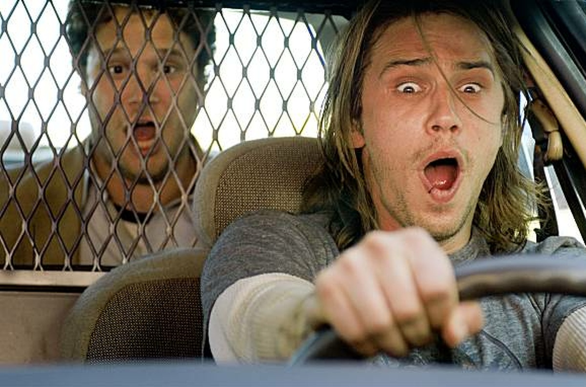 Dale Denton (Seth Rogen, left) and Saul Silver (James Franco, right) are two lazy stoners running for their lives in Columbia Pictures' action-comedy Pineapple Express.