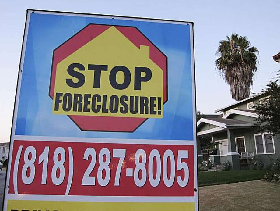 FILE - In this file photo taken Aug. 8, 2010, a foreclosure sign is posted outside a home in Los Angeles. U.S. home repossessions spiked in August to highest level since start of U.S. mortgage crisis. The increase in home repossessions came even as the number of properties entering the foreclosure process slowed for the seventh month in a row, foreclosure listing firm RealtyTrac Inc. said Thursday Sept. 16, 2010. Photo: Paul Sakuma, AP
