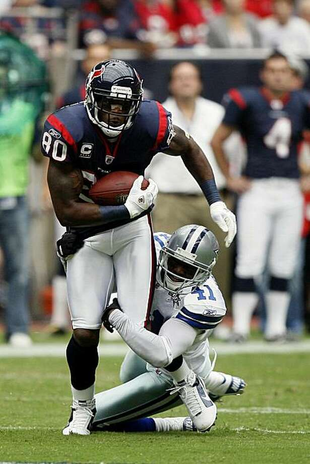 HOUSTON - SEPTEMBER 26:  Wide receiver Andre Johnson #80 of the Houston Texans attempts to shake the tackle of cornerback Terence Newman #41 of the Dallas Cowboys at Reliant Stadium on September 26, 2010 in Houston, Texas. Photo: Bob Levey, Getty Images