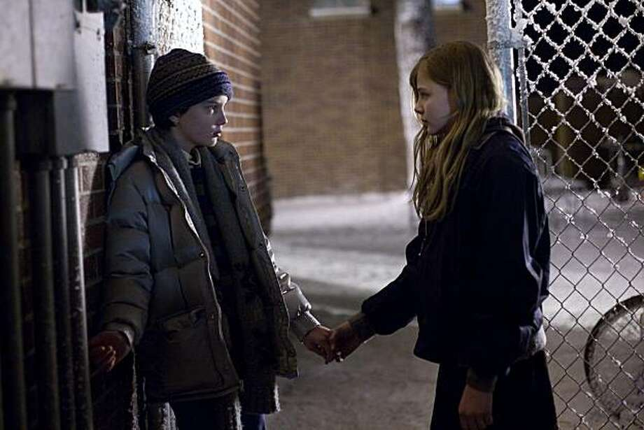 "In this publicity image released by Overture Films, Kodi Smit-McPhee, left, and  Chloe Grace Moretz are shown in a scene from ""Let Me In."" Photo: Saeed Adyani, AP"