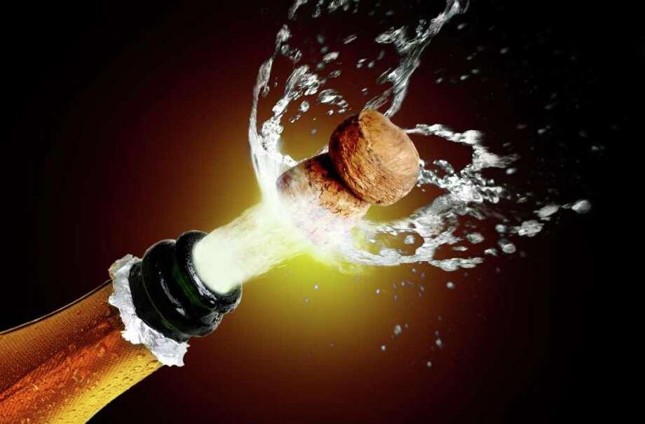 Fotolia   Close up of champagne cork popping celebration Photo: Mikael Damkier / handout / stock agency