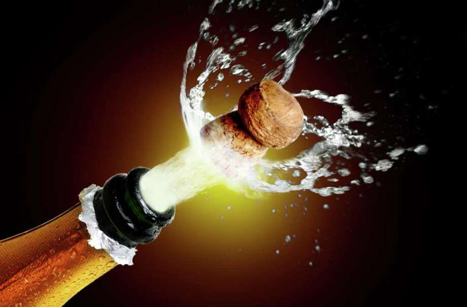 Fotolia   Close up of champagne cork popping celebration Photo: Mikael Damkier / handout / stock agency
