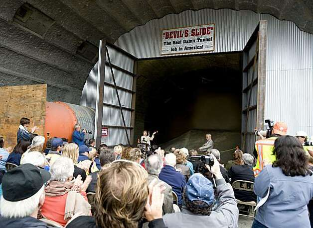 A news conference and celebration is held to commemorate CalTrans' breakthrough of the Devil's Slide bypass tunnel in Pacifica in October 2010. Photo: Chad Ziemendorf, The Chronicle