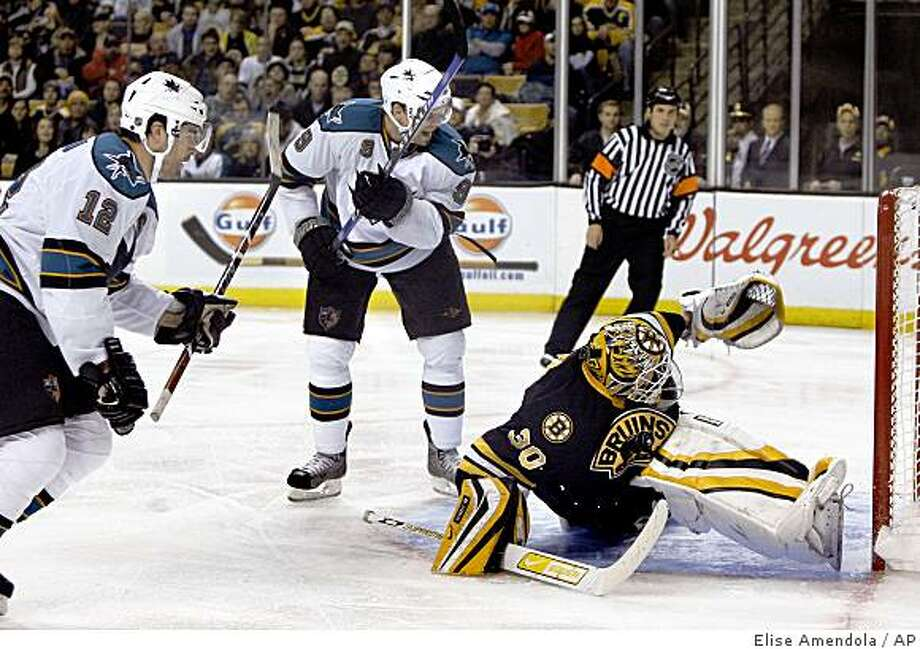 Boston Bruins goalie Tim Thomas (30) turns as the shot by San Jose Sharks center Patrick Marleau (12) goes into the goal while Sharks left wing Milan Michalek (9) reacts during the third period. Photo: Elise Amendola, AP