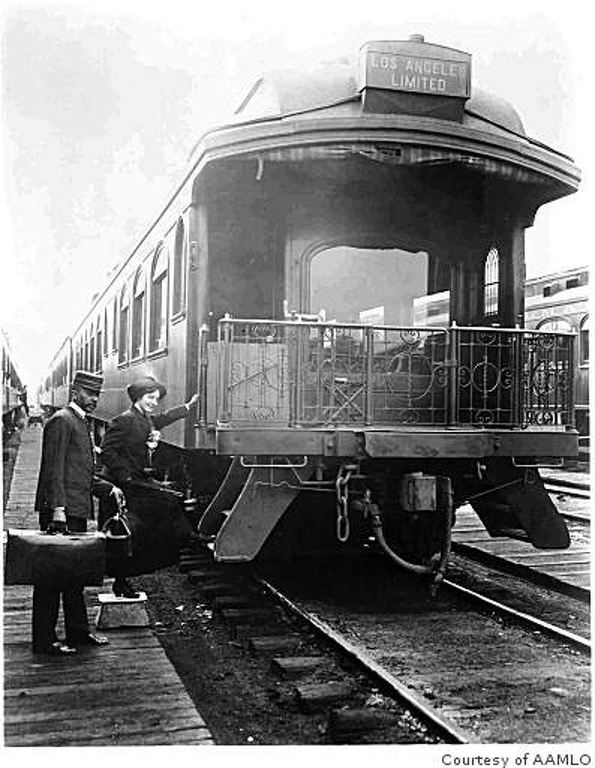 A porter helps a passenger board the observation car of the Los Angeles Limited, early 1900s.