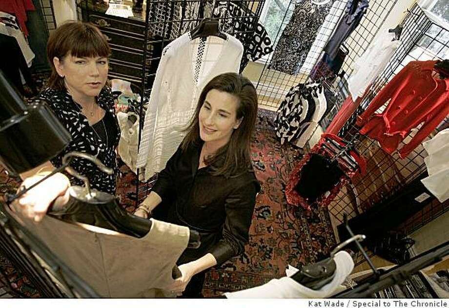 Liz Parkinson, right, shows friend and customer, Marty McGraw a new leather dress from the fashion line named ETC that she shows and sales in her San Francisco, Calif. home on Saturday, January 24, 2009.  Photo by Kat Wade / Special to the Chronicle Photo: Kat Wade, Special To The Chronicle