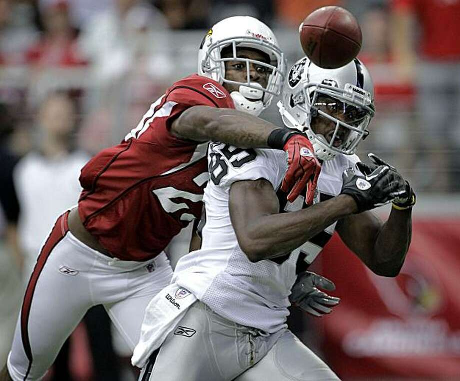 Arizona Cardinals cornerback Dominique Rodgers-Cromartie breaks up a pass intended for Oakland Raiders wide receiver Darrius Heyward-Bey during the first quarter of an NFL football game Sunday, Sept. 26, 2010, in Glendale, Ariz. Photo: Matt York, AP