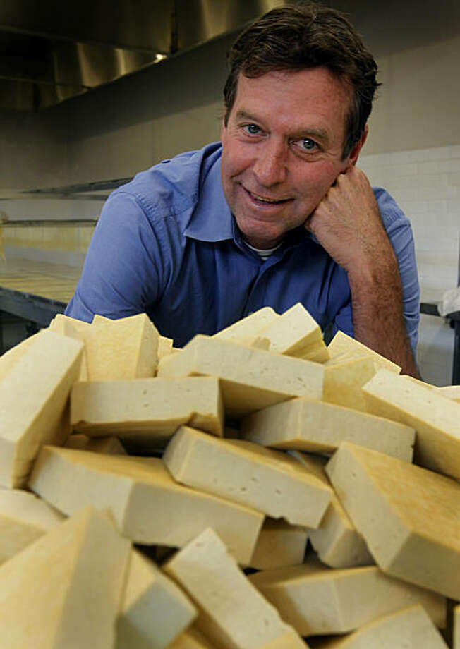Hodo Soy Beanery CEO John Scharffenberger is seen with blocks of extra firm tofu inside the company's facility in Oakland, Calif., on Thursday, Sept. 23, 2010. Photo: Paul Chinn, The Chronicle