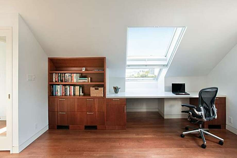 John Sutton Photography & Philip Liang, Ohashi Design Studio   On the uppermost floor, a skylight was added to the bedroom to create a feeling of spaciousness. Photo: John Sutton Photography, Philip Liang - Ohashi Design