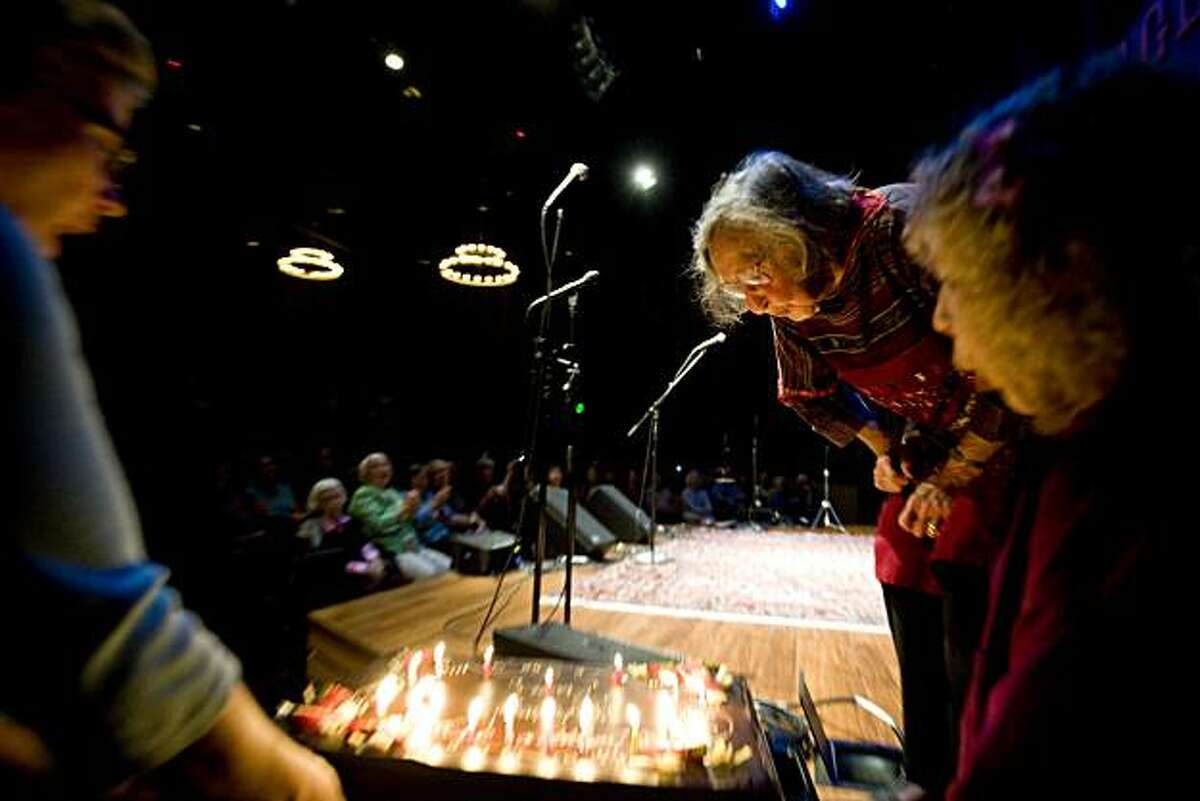 Faith Petric blows out the candles on a surprise birthday cake that was wheeled out to the stage during the show as Faith celebrates her 95th birthday with a concert and Vaudeville variety show at the Freight and Salvage in Berkeley, Calif., on Saturday, September 11, 2010.