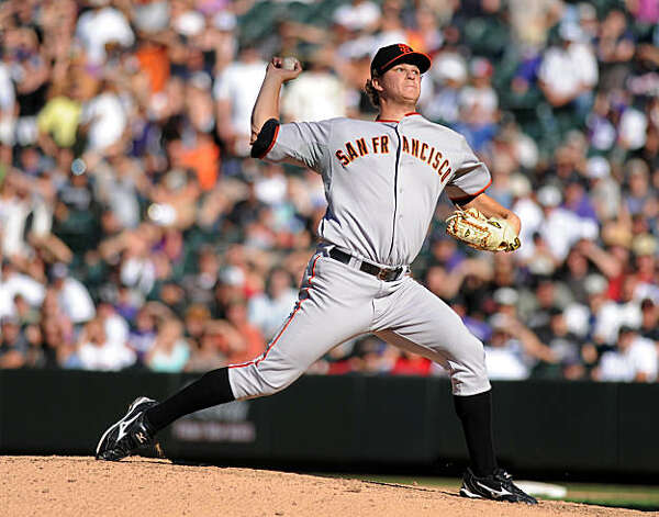 San Francisco Giants starting pitcher Matt Cain throws in the ninth inning of a baseball game against the Colorado Rockies at Coors Field in Denver on Sunday, Sept. 26, 2010. Cain threw a complete game. The San Francisco Giants won 4-2. Photo: Chris Schneider, AP