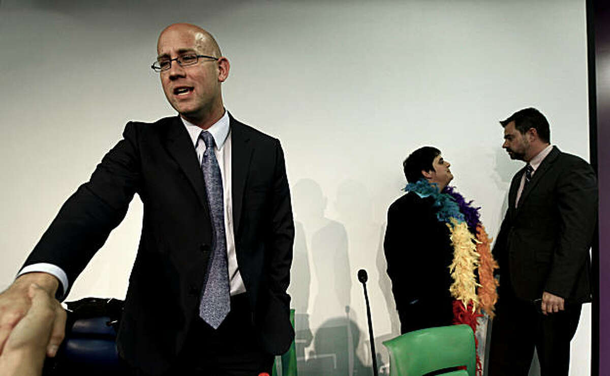 Three of the four candidates for San Francisco Supervisor of District 8, Rafael Mandelman, (left), Rebecca Prozan, and Bill Hemenger (back right), take a break during a forum hosted by the San Francisco Young Democrats at the LGBT Center in San Francisco, Calif., Wednesday, Sept. 22, 2010.
