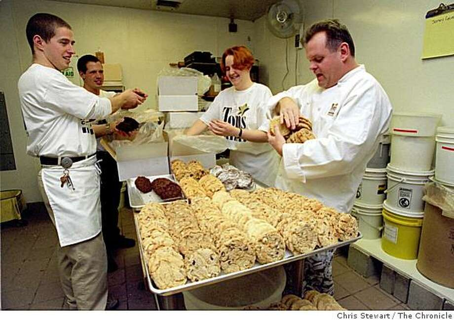 COOKIES 2/C/14JAN97/BU/CS - Tom Roach (R), owner of Tom's Cookies, helps package presidential inaugural cookies with staff at his shop in Macy's Cellar. (L-R) Jim McCormack, Garrett Randall, Danalynn Drane (cq) and Roach. SAN FRANCISCO CHRONICLE PHOTO BY CHRIS STEWART Photo: Chris Stewart, The Chronicle