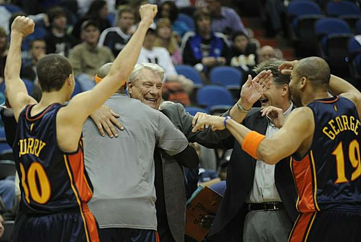 Head coach Don Nelson, center, of Golden State Warriors celebrates with his fellow coaches and players following a basketball game against the Minnesota Timberwolves at Target Center on April 7, 2010 in Minneapolis, Minnesota. The Warriors defeated the Timberwolves 116 to 107.