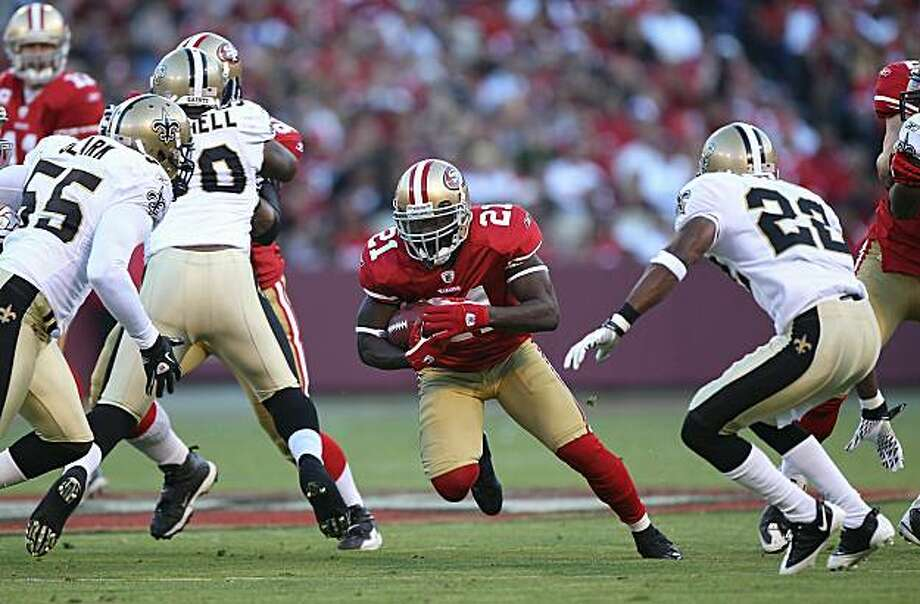 SAN FRANCISCO - SEPTEMBER 20:  Frank Gore #21 of the San Francisco 49ers runs against the New Orleans Saints during an NFL game at Candlestick Park on September 20, 2010 in San Francisco, California. Photo: Jed Jacobsohn, Getty Images