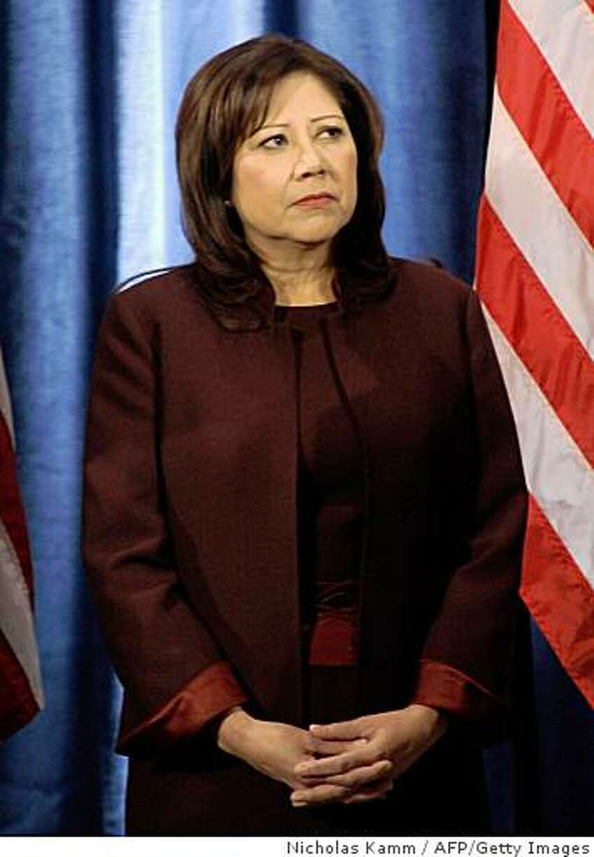 California Rep. Hilda Solis listens to US president-elect Barack Obama at a press conference in Chicago on December 19, 2008. Obama introduced Solis as his labor secretary, former Dallas mayor Ron Kirk as trade representative, retired Admiral Dennis Blair as Director of National Intelligence (DNI) and Republican Rep. Ray LaHood of Illinois for transportation secretary. AFP PHOTO/Nicholas KAMM (Photo credit should read NICHOLAS KAMM/AFP/Getty Images)