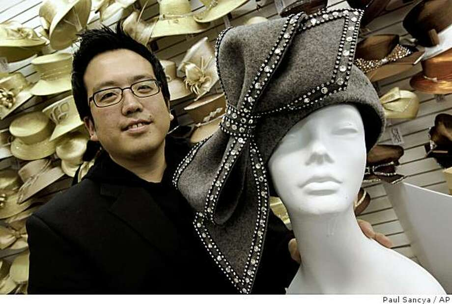 """Luke Song, 36, designer of the hat Aretha Franklin wore while singing """"My Country 'Tis of Thee"""" during President Barack Obama's inauguration shows a replica of the hat at Mr. Song Millinery in Detroit. Photo: Paul Sancya, AP"""