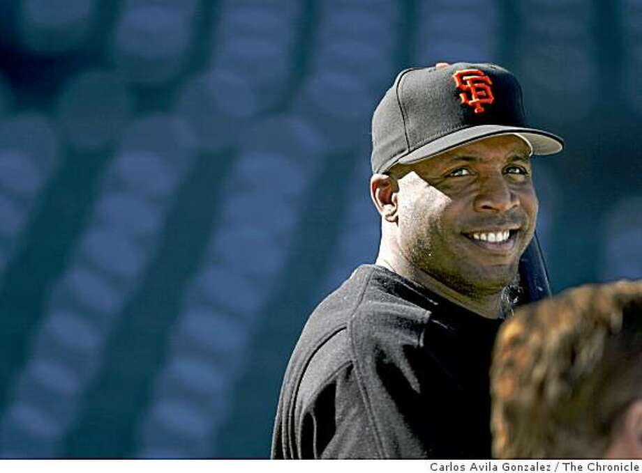 San Francisco Giants slugger, Barry Bonds, speaks with members of the press during batting practice before the start of a game against the Oakland Athletics on June 27, 2003. Photo: Carlos Avila Gonzalez, The Chronicle