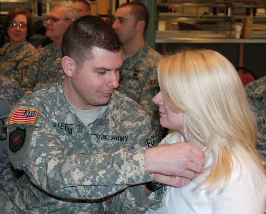 NEW YORK ARMY NATIONAL GUARD New York Army National Guard Capt. Mark Stetzko of the 501st. Ordnance Battalion, pins a Army National Guard pin on his fiance Laura Zadzilka during a Freedom Salute ceremony in Scotia in recognition of her support while he was serving in the Iraq war.