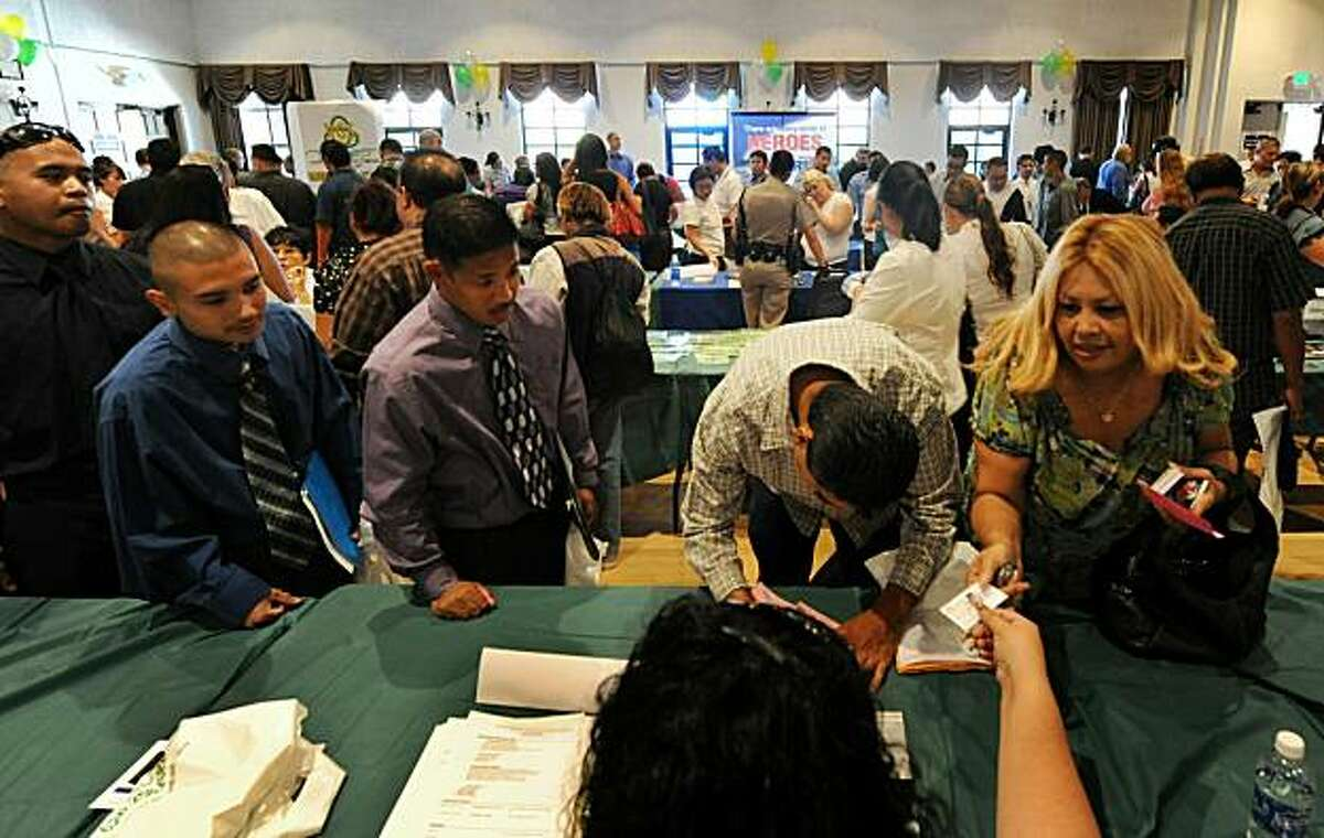 Unemployed Americans attend a job fair on the first day of the Labor Day long weekend in the City of El Monte outside of Los Angeles on September 4, 2010. US unemployment jumped to 9.6 percent in August, the Labor Department said, showing the recovering economy is still struggling to create jobs. In a keenly awaited unemployment report, the department said the economy lost 54,000 jobs last month, a better figure than the 120,000 loss expected by economists. The figures are seen as a crucial litmus test for the sputtering economic recovery and President Barack Obama's policies.