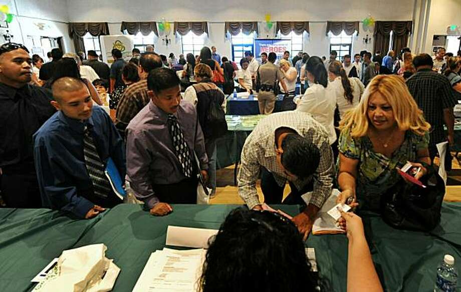 Unemployed Americans attend a job fair on the first day of the Labor Day long weekend in the City of El Monte outside of Los Angeles on September 4, 2010. US unemployment jumped to 9.6 percent in August, the Labor Department said, showing the recovering economy is still struggling to create jobs. In a keenly awaited unemployment report, the department said the economy lost 54,000 jobs last month, a better figure than the 120,000 loss expected by economists. The figures are seen as a crucial litmus test for the sputtering economic recovery and President Barack Obama's policies. Photo: Mark Ralston, AFP/Getty Images