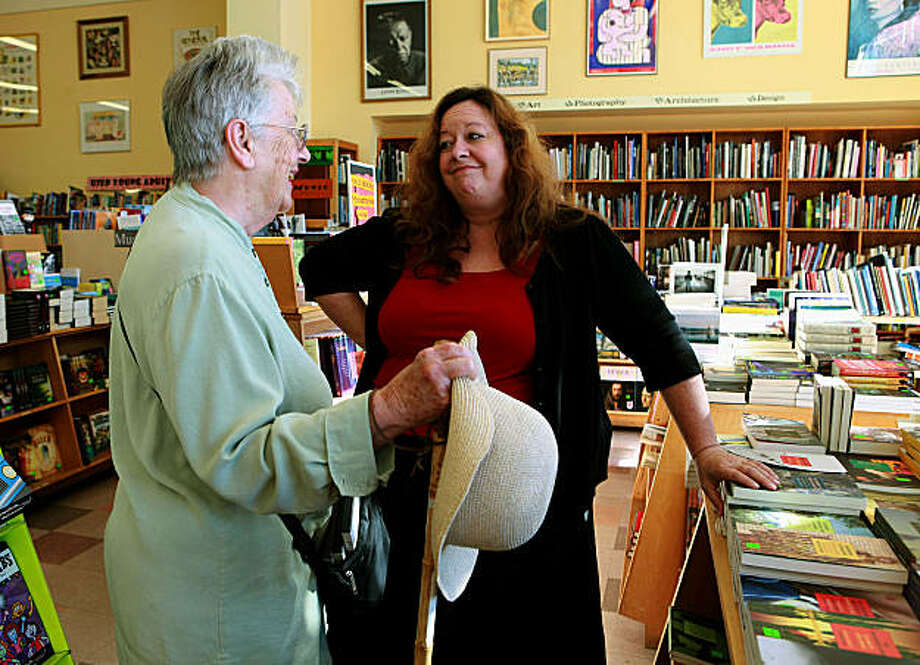 "Amy Thomas (right), owner of Pegasus Books, talking about walking canes with Berkeley author Dorothy Bryant who's written ""Kin of Ata"" in Berkeley, Calif., on Monday, September 20, 2010.  Pegasus Books is eligible for new tax credits going into effect asAmy Thomas (right), owner of Pegasus Books, talking about walking canes with Berkeley author Dorothy Bryant who's written ""Kin of Ata"" in Berkeley, Calif., on Monday, September 20, 2010.  Pegasus Books is eligible for new tax credits going into effect as part of the health reform law. Photo: Liz Hafalia, The Chronicle"