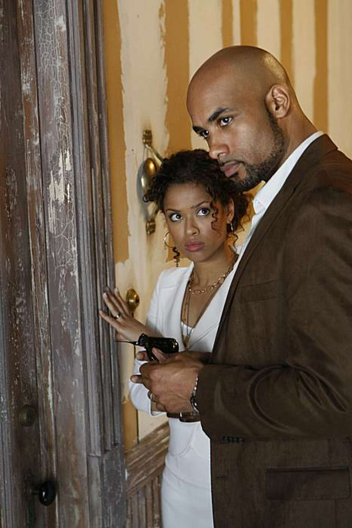 Caption: UNDERCOVERS -- Pilot -- Pictured: (l-r) Gugu Mbatha-Raw as Samantha Bloom, Boris Kodjoe as Steven Bloom.